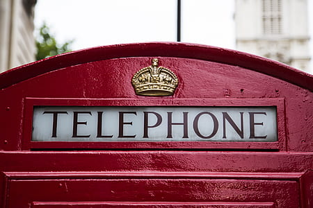 red and white Telephone booth sign