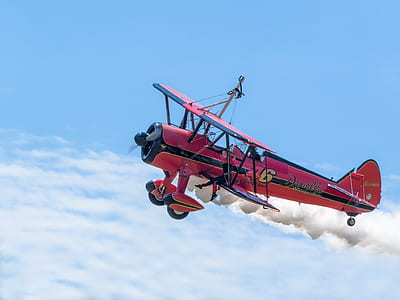 red and black biplane