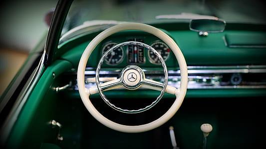 photo of white Mercedes-Benz steering wheel