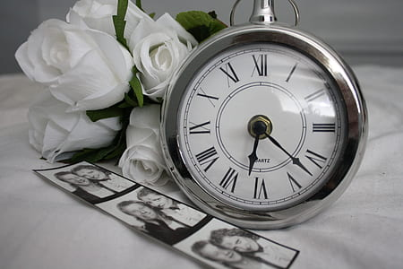 round silver-colored analog clock