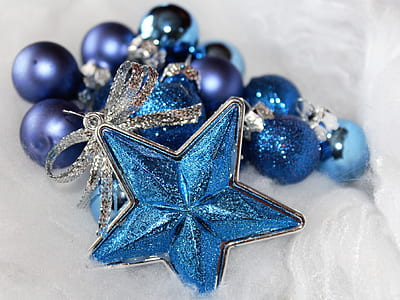 blue and purple baubles on white surface