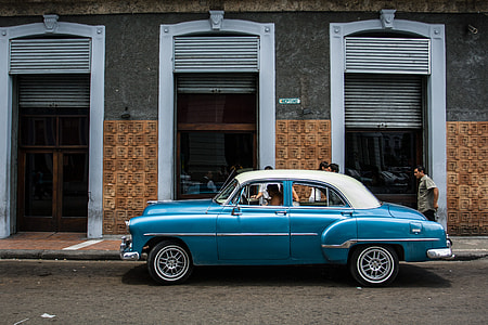 A classic car sits on an old street in Havana, Cuba. Image captured with a Canon DSLR