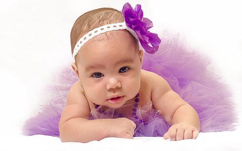 baby wearing purple tutu skirt