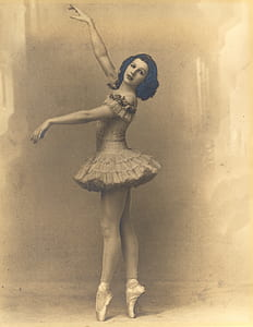 photo of woman wearing ballet dress