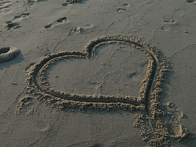 heart sand drawing during daytime