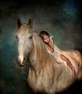 girl riding on white horse