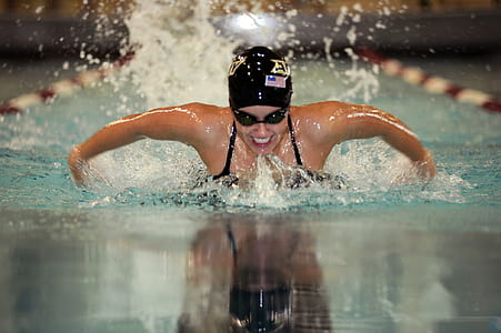 swimmer athlete using butterfly swim on competing pool