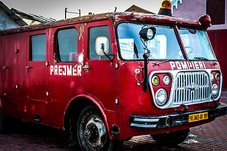 red fire truck under blue skies during daytime