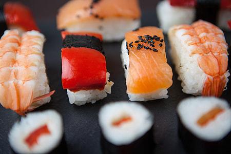 Close-up macro shot of fresh sushi fish resting on a slate