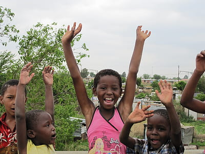 group of children raising hands