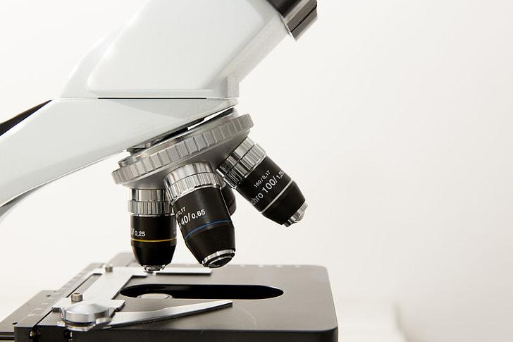 white and black microscope