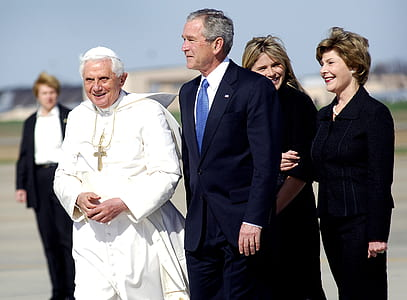 Pope with man wearing blue suit jacket