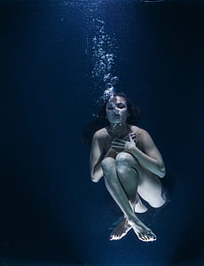 underwater photography of woman underwater