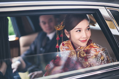 woman wearing multicolored cheongsam dress