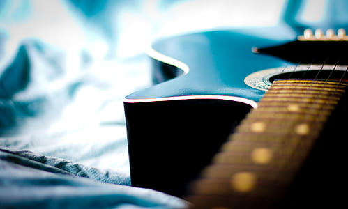 photography of black guitar