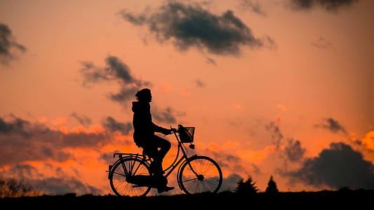 person biking silhouette