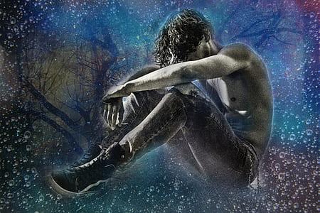 man wearing gray denim jeans sitting on stars