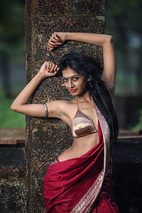 woman in bronze-colored brassiere and red sari dress