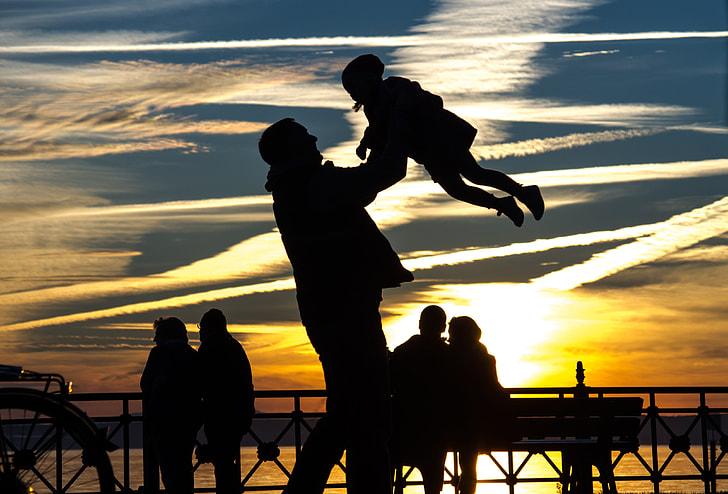 man lifting kid photo