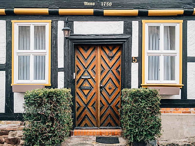 brown and black wooden french door closed