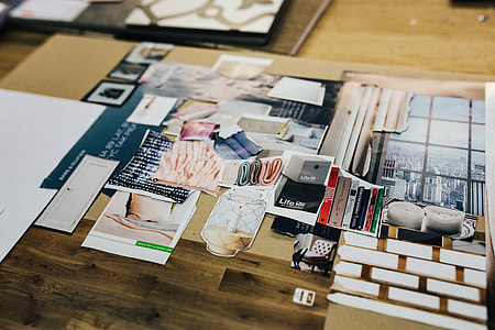Designers working with material samples and paper cutouts