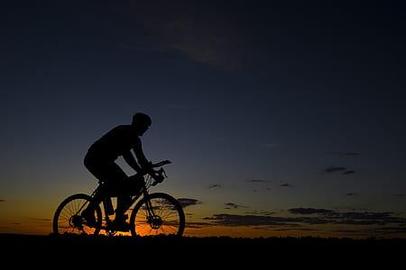 silhouette photo of biker