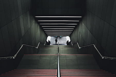 person walking near the stairs