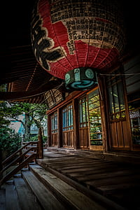 Red Green and Black Floating Lantern With Kanji Text Decoration Above Stairs