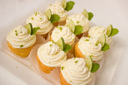 nine white icing covered cupcakes