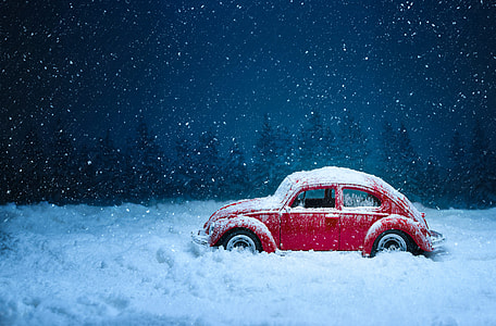 red Volkswagen beetle on ice