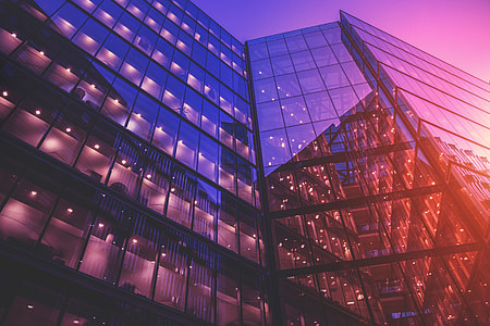Glass office buildings and light reflections at sunset