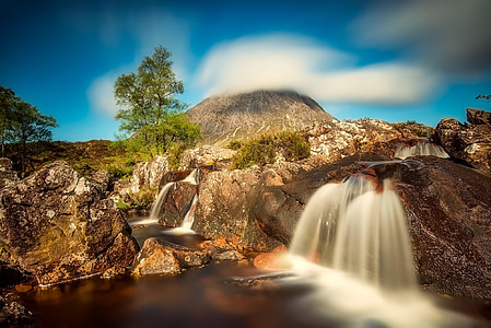high-saturated photo of waterfalls