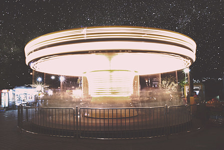 time lapse photography of lighted horse carousel under clear starry sky