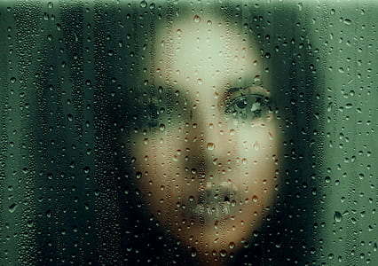 photo of woman in frosted glass