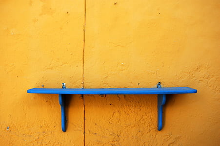 blue wooden wall mounted rack