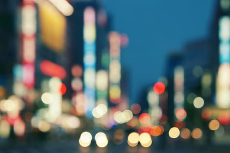 bokeh photography of city buildings and stret