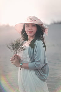Woman Holding Brown Twig