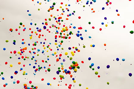 assorted-color balloons flying in the sky