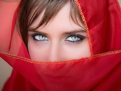 closeup photography of woman in red headdress