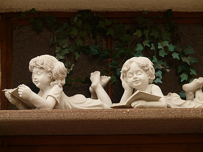 two girl and boy reading books statuette