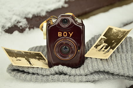 closeup photo of brown Boy camera on knit cap