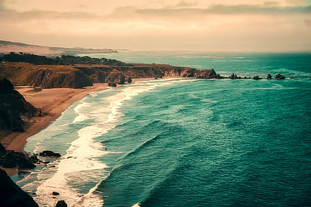 aerial view photography of beach under cloudy skies