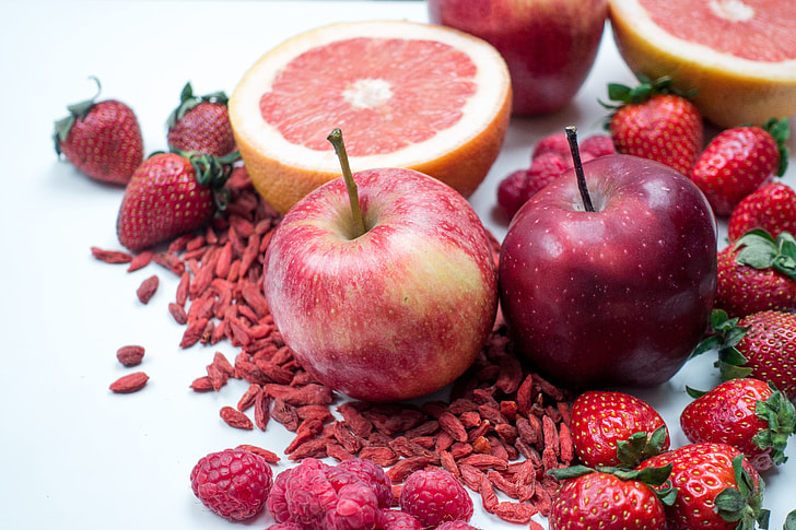 Red apples with other red fruit