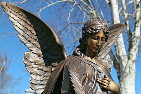 selective focus photography of angel statue
