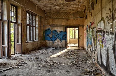 graffiti on wall inside run-down building