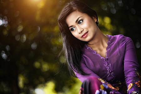 selective focus photography of woman in purple v-neck long-sleeved dress