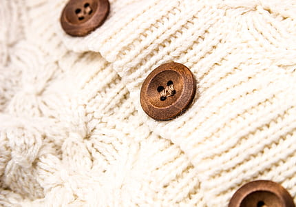 white knit apparel with brown buttons