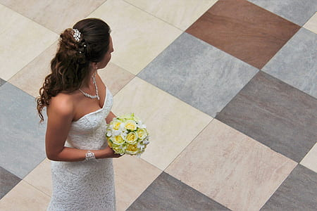 woman wearing white wedding dsress