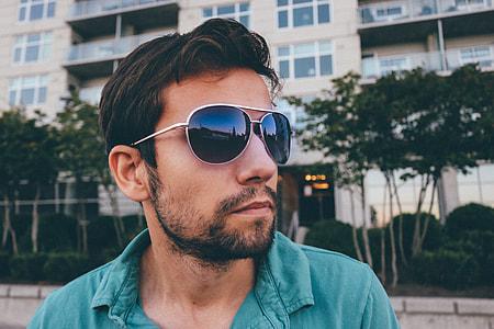 photo of man wearing black sunglasses