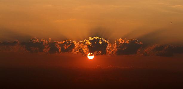 sun under black sky